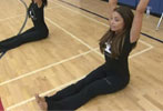 Trish Stratus shows students yoga